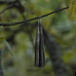 vihreät nahkaiset korvakorut